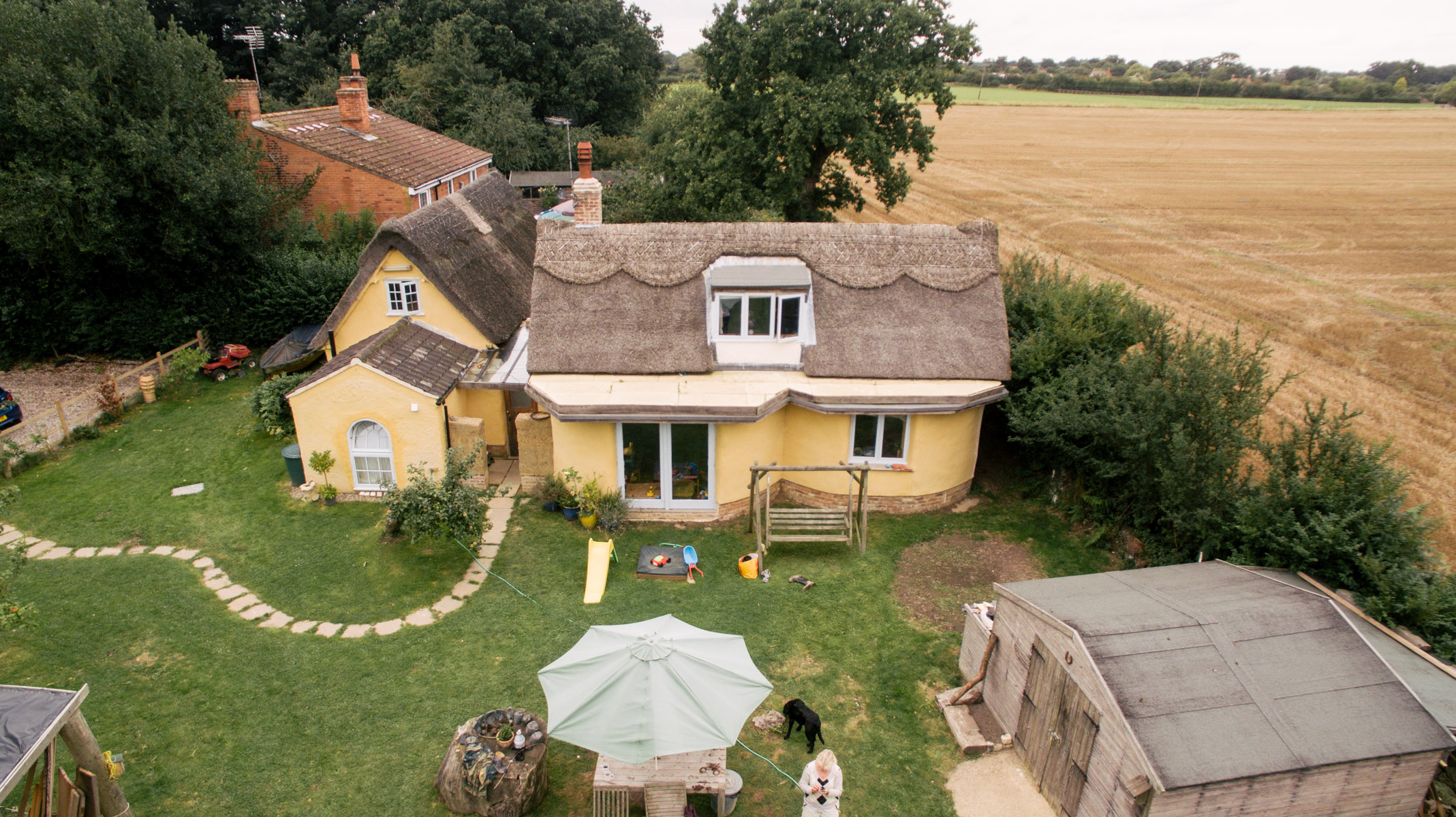 The cob house from the air built by kate edwards and for Building a house in texas