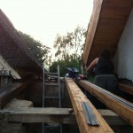 Kate attaches solid oak reclaimed rafters to the porch roof