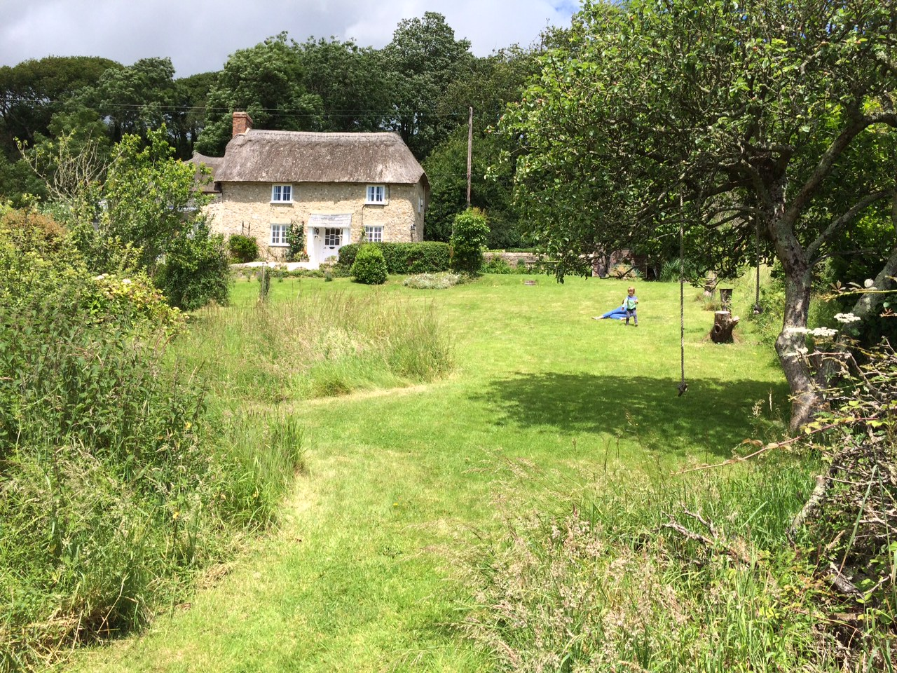 The Grade II listed cottage and grounds where our cob workshops take place.